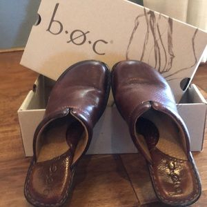 Dark brown leather slip on clogs.